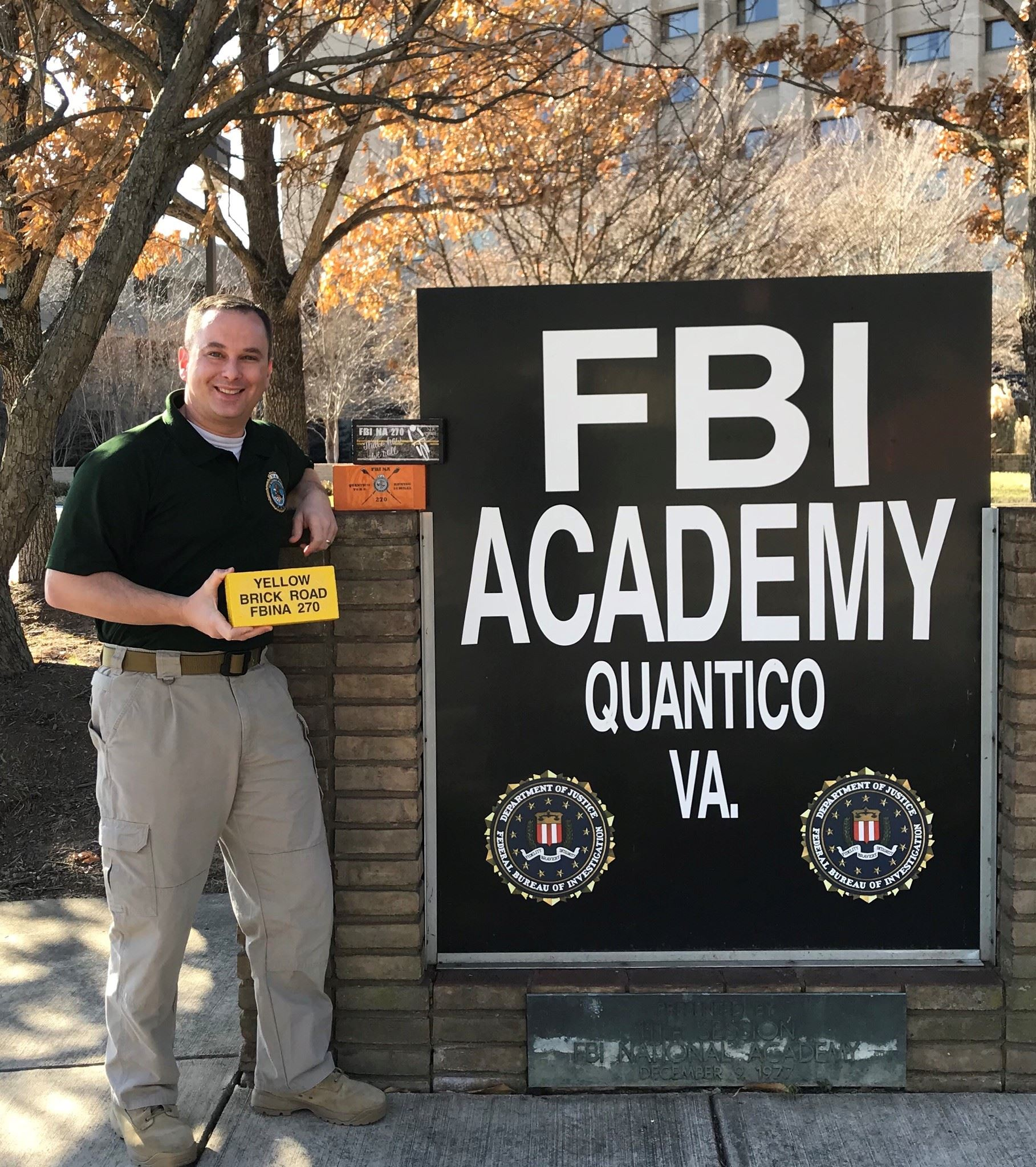 Lieutenant Clay Hammac standing in front of FBI Academy Sign