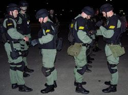 Tactical Response Unit Members Line up at Night